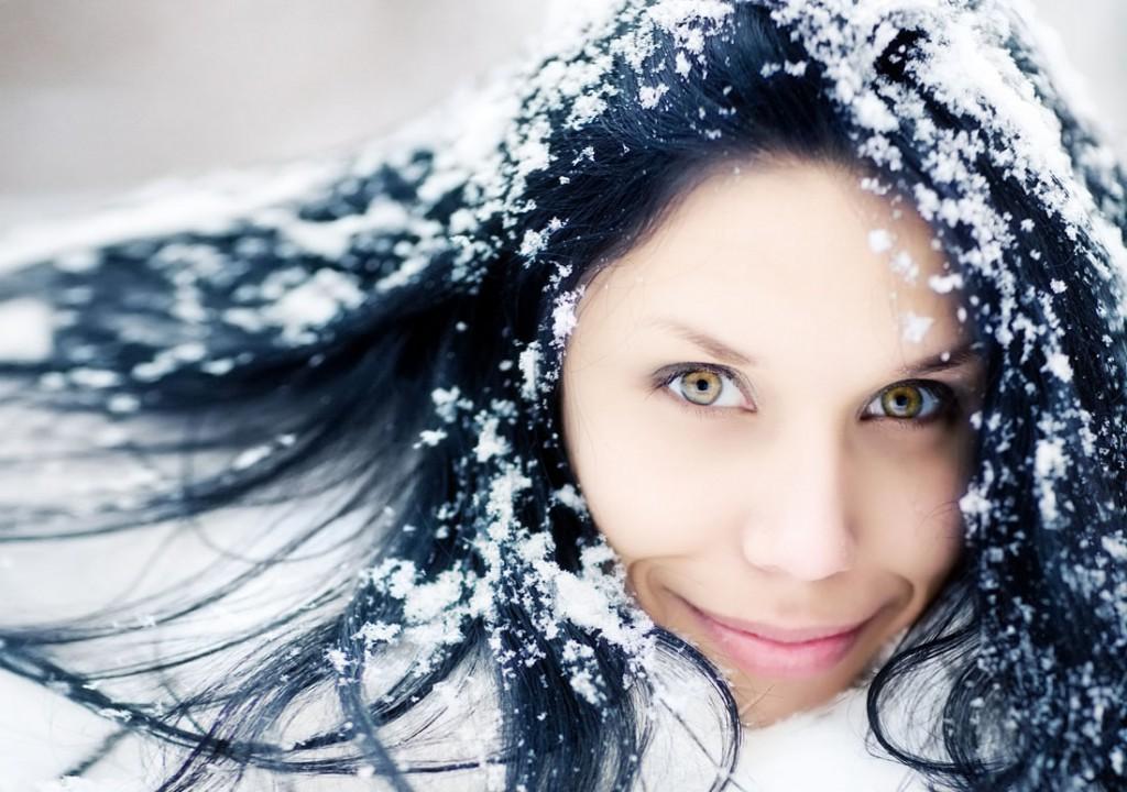 Woman winter portrait with snow.
